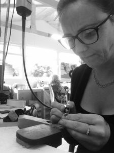 chloe michell working at her bench in her jewellery workshop
