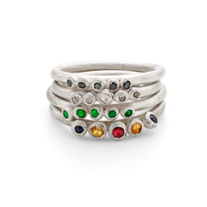 set of 4 stacking rings by chloe michell jewellery. Gem stones included in the alertnative engagement rings are green emeralds, mulit coloured sapphires, black and natural diamonds