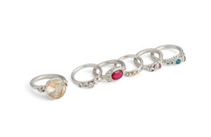 assortment of alternative bridal engagement rings. large and small stones all set in sterling silver. Includes diamond, rutilated quartz, ruby and sapphires